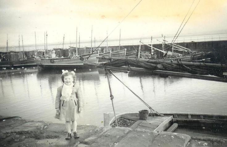 A bonnie wee lassie inspecting the fleet circa 1955.